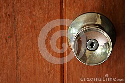 Door knob on wooden door