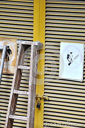 Door with ladder in industrial environment