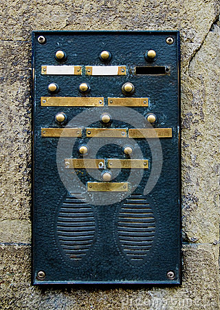Doorbell plate in a stone wall.