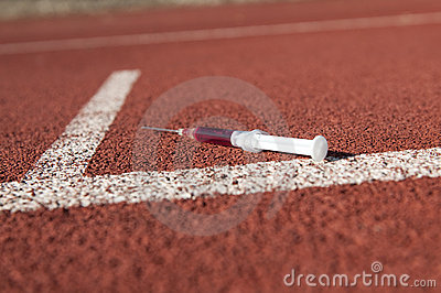 Doping syringe on athletics sports area