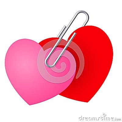 Dos corazones fijados juntos.