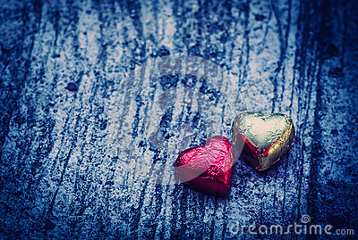 Double Chocolate Heart Shape On Grunge background with blue ligh