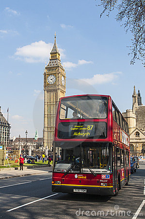Double-decker bus driving by Big Ben Editorial Photography