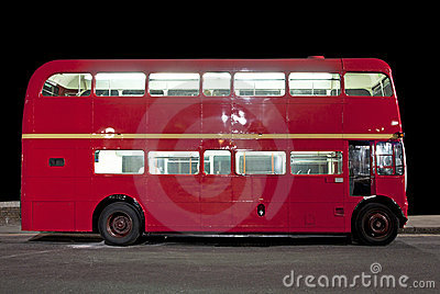 Double decker bus at night