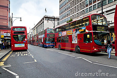 Double decker buses in London s Oxford street Editorial Stock Photo