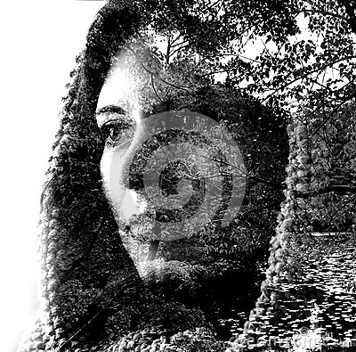 Free Double Exposure Of A Young Beautiful Girl Through The Branches And Leaves. Portrait Of A Woman, Mysterious Look, Sad Eyes, Creativ Royalty Free Stock Photography - 99109247