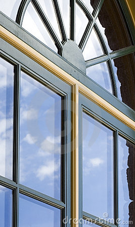 Free Double-paned Windows With Cloud Reflections Stock Image - 401671