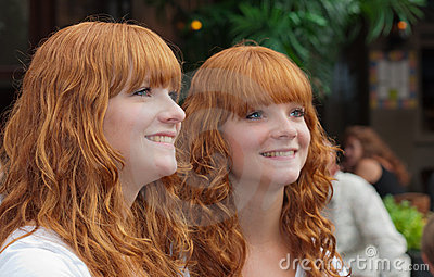 Double portrait of two redheaded girls Editorial Stock Image