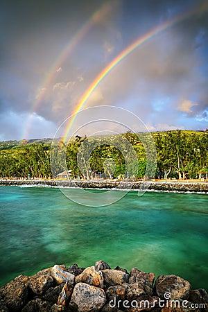 Double rainbow by the coast