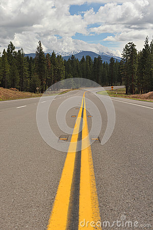 Double yellow lines on road into the distance