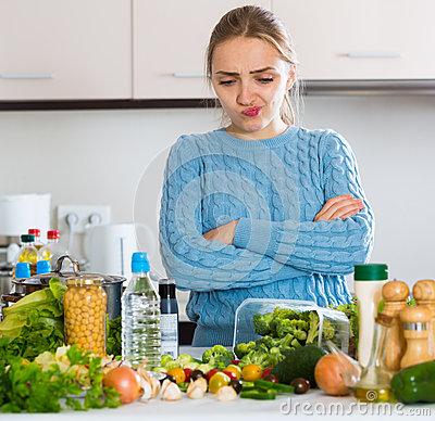 Free Doubting Girl Thinking What To Cook For Dinner Stock Photos - 68158133