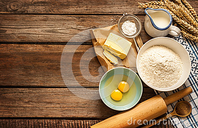 Dough recipe ingredients on vintage rural wood kitchen table