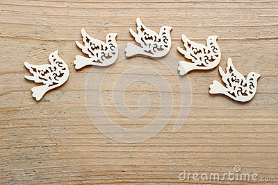 Dove of peace on wooden background