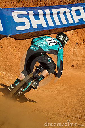 Downhill rider through corner at UCI MTB World Cup Editorial Stock Photo