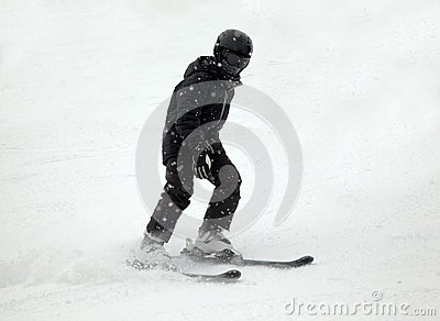 Downhill skier in black