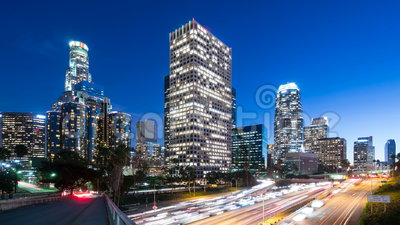 Downtown Los Angeles and freeway traffic Time lapse. Downtown Los Angeles and freeway traffic at dusk, time lapse