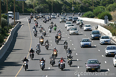 Dozens of motorcycle riders