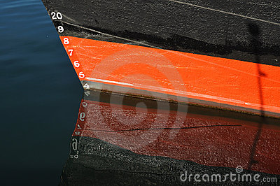 Draft Markings on red and black boat
