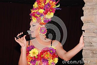 Drag queen singing.