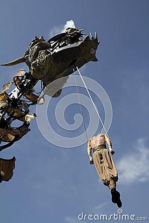 Dragon and acrobat Editorial Stock Photo
