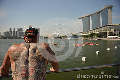 Dragon boats racing to finish DBS river Regatta 2013 Editorial Image