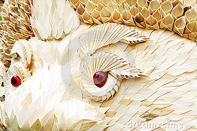 Dragon body is made from leaves and red eye