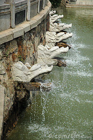 Free Dragon Water-Spigots At Gardens Of The Sun-Moon Goddess Stock Image - 1155921
