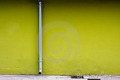 Drainpipe on a Green Wall