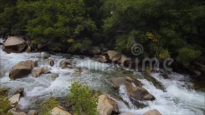 Dramatic boulders and ragging creek stock video footage