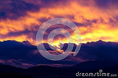 Dramatic cloudscape over silhouette hills