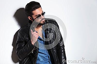 Dramatic fashion model pulling his collar