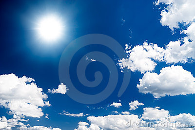 Dramatic high contrast blue sky with sun