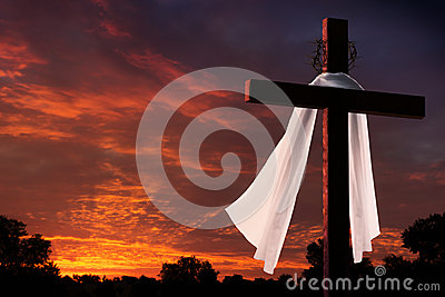 Dramatic Lighting on Christian Easter Morning Cross At Sunrise