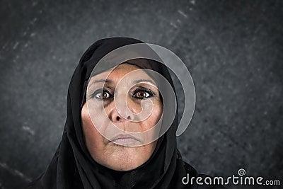 Dramatic muslim woman