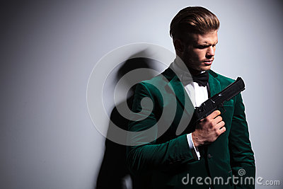 Dramatic picture of a serious young hitman