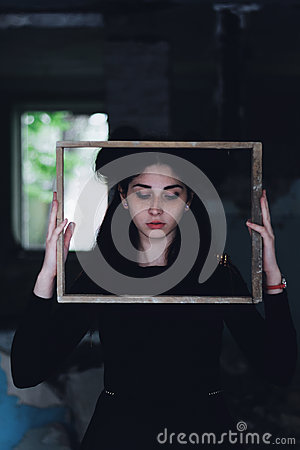 Free Dramatic Portrait Of A Young Beautiful Girl. A Girl With A Pleasant Appearance And Sad Look. Creative Portrait Of A Woman. Attract Royalty Free Stock Image - 99109496