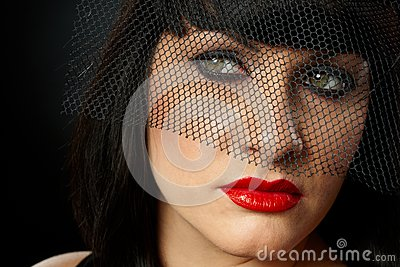 Dramatic portrait of young woman in veil