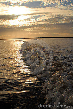 Dramatic seascape under golden sunrise.