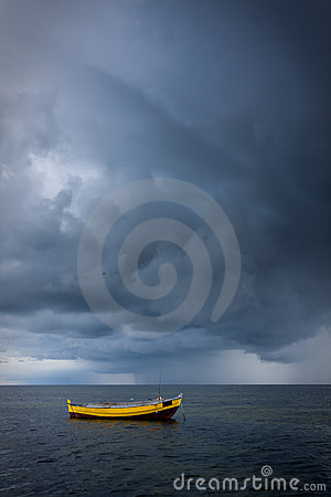 Dramatic sky over boat in sea