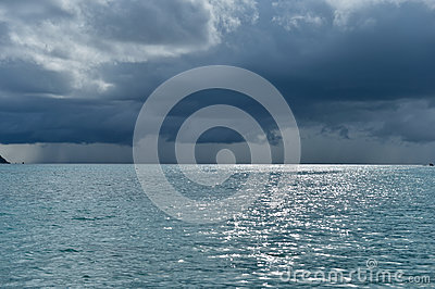 Dramatic storm clouds over tropical island