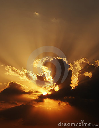 Dramatic sundown scene with dark clouds and rays