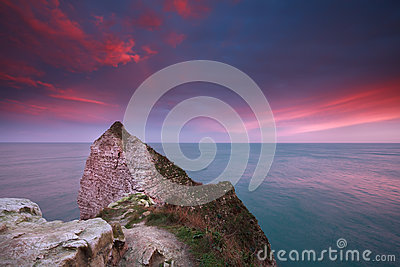 Dramatic sunrise over Atlantic ocean and cliffs