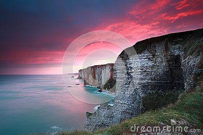 Dramatic sunrise over cliffs in Atlantic ocean