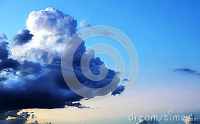 Dramatic unique storm cloud on beautiful blue sky