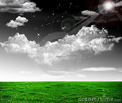 Drastic skies against a green field beautiful cont