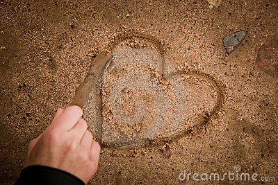 Drawing heart on ground