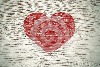 Drawing love symbol on old wooden wall
