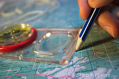 Drawing pencil and compass on the map