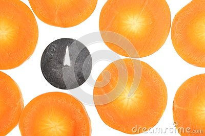 Drawing Pin Among Carrot Slices