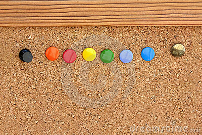 Drawing pins in a cork pinboard